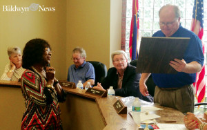 Baldwyn Mayor Michael James presents Barbara Kohlheim with a plaque of appreciation for her late husband's service to the city. (News Photo/Demi Roberts)