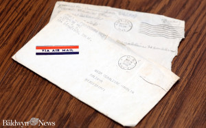 The Cunninghams have held on to love letters sent between them while Jimmy was in the war. Above, envelopes with postmarks dated in 1945. (News photo/Jason Collum)