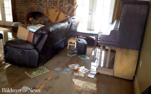 An upright piano in the home of Burt and Tammy Ballard shows how high flood waters came in their home in Louisiana. (Photo courtesy of Burt Ballard)